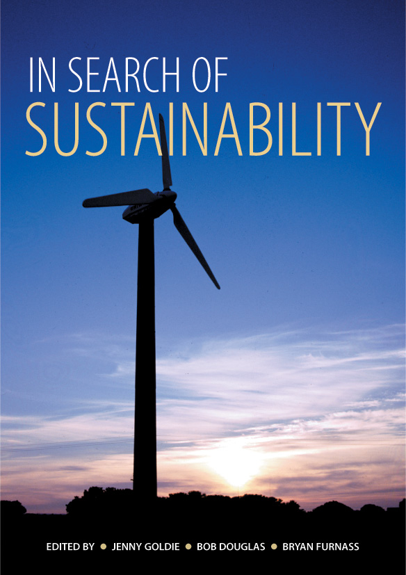 The cover image of In Search of Sustainability, featuring a wind turbine s
