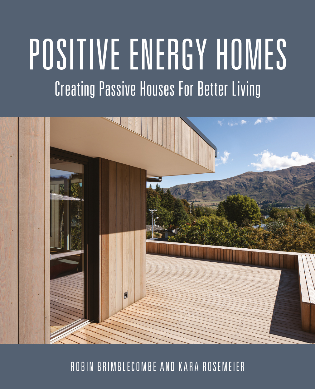Cover of Positive Energy Homes featuring exterior photograph of wooden hom