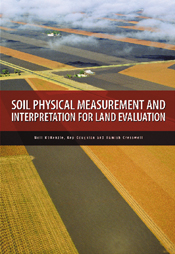 The cover image featuring an arial view of long yellow and brown fields.