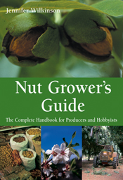 The cover image of Nut Grower's Guide, featuring two nut cases emerging fr