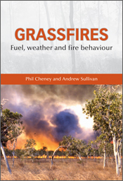The cover image of Grassfires, featuring a grass fire viewed from a distan