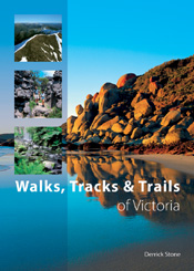 The cover image featuring a rocky beach embankment reflected in bright blu