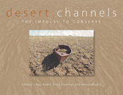 The cover image of Desert Channels, featuring a canoe on dried cracked ear