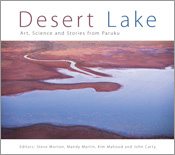 The cover image of Desert Lake, features an arial view of a dark blue lake