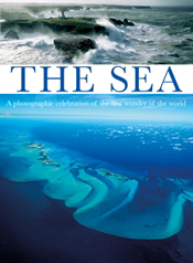 Cover has two sea images one bright blue, the other close up of crashing w