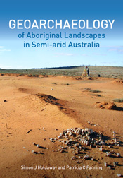 The cover image featuring a brown desert expanse with sparse pebbles with