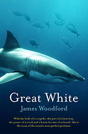 Cover image is a partial side view of a great white against a blue ocean b