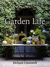 Cover image is a garden table with potted plants against a green foliage c