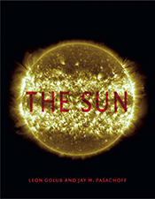 Cover with large yellow glowing sun on a black background, with red text.